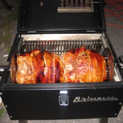 rotisserie chicken is juicy and delicious when it's slow cooked on the Lunchbox Charcoal Grill is the best small charcoal grill for tailgating, beach parties, rotisserie grilling, BBQ ribs, chicken, pork, steaks and chicken thighs and drumsticks, made in the u.s.a.
