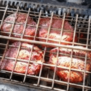 texas loves ribeye steaks grilled on lunchbox charcoal grill is best small charcoal grill for bbq, rotisserie and traditional grilling. Made in U.S.A. and cooks chicken, prime rib, pork roast, turkey, steak and hamburgers on stainless steel grates and rotisserie.
