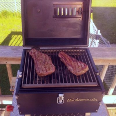 steaks are great grilled on Lunchbox Charcoal Grill is the best small charcoal grill for tailgating, beach parties, rotisserie grilling, BBQ ribs, chicken, pork, steaks and chicken thighs and drumsticks, made in the u.s.a.